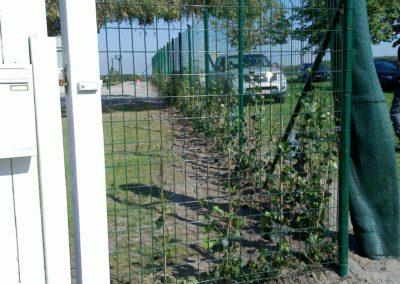 Pose de poteaux pour clôture à Mons