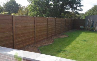Clôture en béton à l'effet bois pour votre jardin